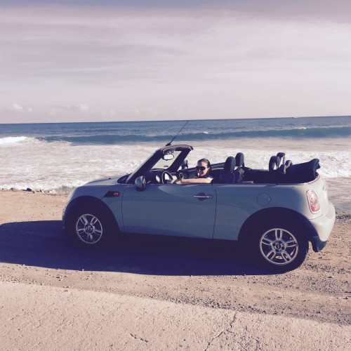 Me in our Mini Cooper enjoying the view at Grand Fond beach.